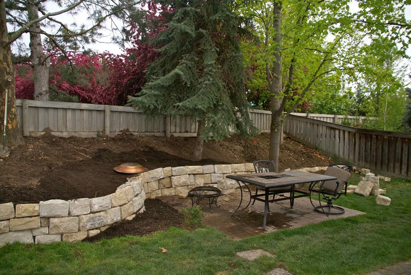 Hill Backyard : We tamed our sloped hill in our backyard by putting up a sand stone